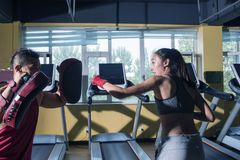 The Woman free sparring At The Gym and coaches. Women free sparring At The Gym stock image