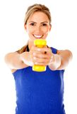 Woman with free-weights Royalty Free Stock Photo