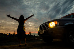 Woman freedom sunset. Woman freedom in sunset with car royalty free stock image