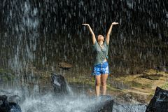 Woman freedom under waterfall Stock Photos