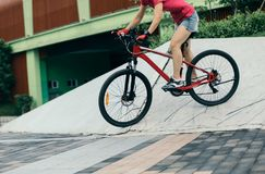 Woman freerider riding down ramps Royalty Free Stock Photo