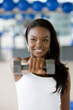 Woman with freeweights Stock Photography