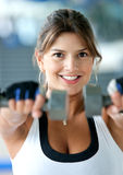 Woman with freeweights Stock Images