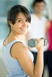 Woman with freeweights Royalty Free Stock Image