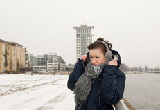 Woman freezing on a winter day Stock Image