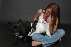 Woman with French bull dogs Stock Photography