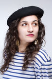 Woman with French Style Beret Hat and Striped T-shirt Royalty Free Stock Image
