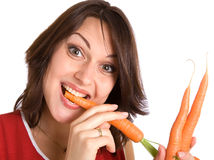 Woman with fresh carrots Royalty Free Stock Photo
