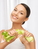 Woman with fresh celery Royalty Free Stock Photos