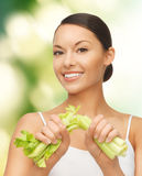 Woman with fresh celery Stock Photos