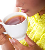 Woman with fresh cup of tea Stock Images