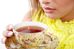 Woman with fresh cup of tea Royalty Free Stock Images