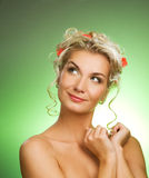 Woman with fresh flowers. Beautiful young woman with fresh flowers in her hair looking up. Spring concept stock image