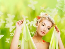 Woman with fresh flowers in her hair. Royalty Free Stock Images
