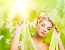 Woman with fresh flowers in her hair. Royalty Free Stock Photography