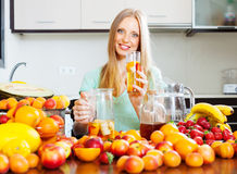 Woman with fresh fruit beverage Stock Photography