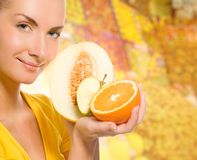 Woman with fresh fruits Stock Photography