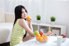 Woman with fresh fruits orange Stock Images