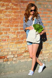 Woman with fresh green vegetables in bag Stock Photography