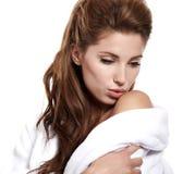 Woman with fresh healthy skin applying moisturiz Stock Photos