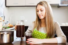Woman with fresh kvass in jug Royalty Free Stock Photo