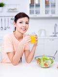 Woman with fresh orange juice Royalty Free Stock Image