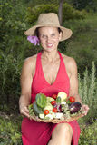 Woman with fresh picked vegetables Royalty Free Stock Photo