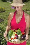 Woman with fresh picked vegetables Royalty Free Stock Images
