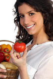 Woman fresh produce. Woman with a basket of fresh produce Stock Image