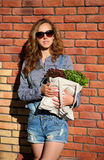 Woman with fresh raw food in bag. Healthy lifestyle Stock Image