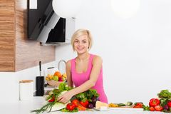 Woman fresh raw vegetables cooking at home Royalty Free Stock Images