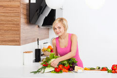 Woman fresh raw vegetables cooking at home Royalty Free Stock Photo