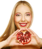 Woman with fresh red pomegranate Stock Photography