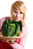 Woman with fresh savoy cabbage and onions Stock Images