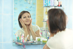 Woman with fresh skin. Of face in bathroom royalty free stock photo