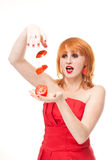 Woman with fresh sliced tomato. Portrait of young attractive redhead in red dress holding fresh sliced tomato, isolated on white background Stock Photos