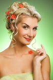 Woman with fresh spring flowers. Beautiful young woman with fresh spring flowers in her hair. Spring concept stock photography