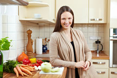 Woman with fresh vegetables Stock Photography