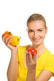 Woman with fresh vegetables Royalty Free Stock Photography