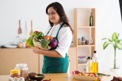 Woman with fresh vegetables Royalty Free Stock Images