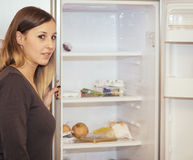 Woman fridge Royalty Free Stock Image