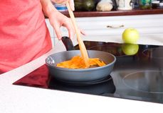 Woman fried carrot Stock Photos