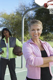Woman With Friend At Basketball Court Royalty Free Stock Photography
