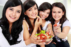 Woman friend having salad together Royalty Free Stock Images