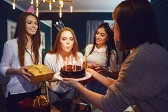 Woman with friends celebrating birthday royalty free stock photo