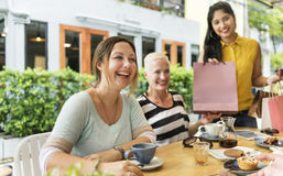 Woman friends having tea after shopping royalty free stock photos