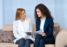Woman friends at home reading Royalty Free Stock Photography
