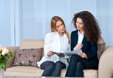 Woman friends at home reading Stock Photos
