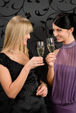 Woman friends party dress toast champagne glass. Two women friends party dress toast champagne glass smiling together Stock Image