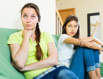 Woman friends sitting and discontent Stock Photography